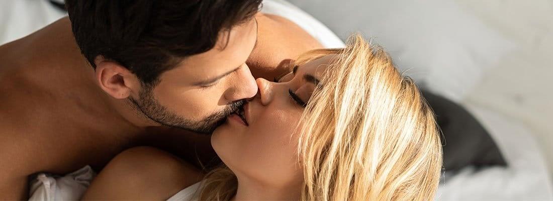 men and woman kissing
