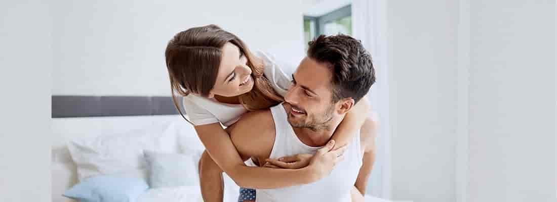 young couple smile together